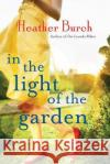 In the Light of the Garden Heather Burch 9781503941144 Lake Union Publishing